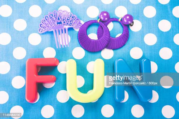 fun made of plastic letters, blue dotted background - rhinestone stock pictures, royalty-free photos & images