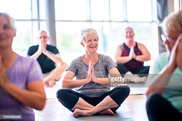 fun meditation - senior adult stock pictures, royalty-free photos & images