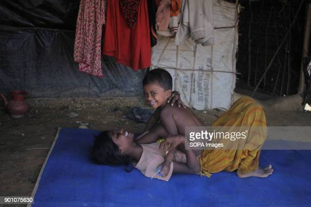 Fun moment of a Rohingya child with his sister in the Refugee Camp More than 600000 Rohingya refugees have fled from Myanmar Rakhine state since...