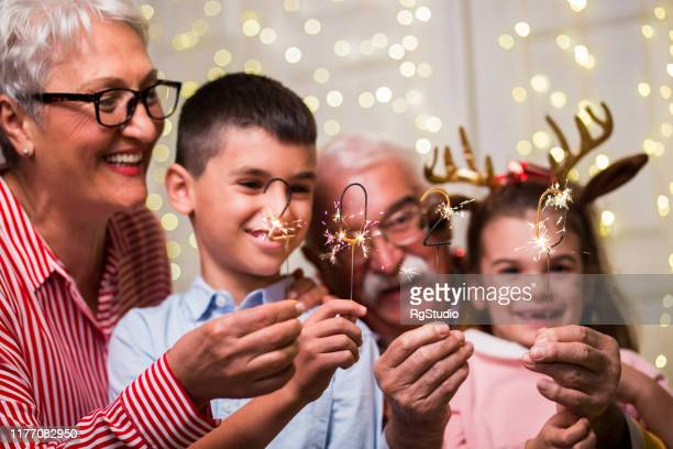 fun new year's eve with grandparents - happy new year 2020 stock photos and pictures
