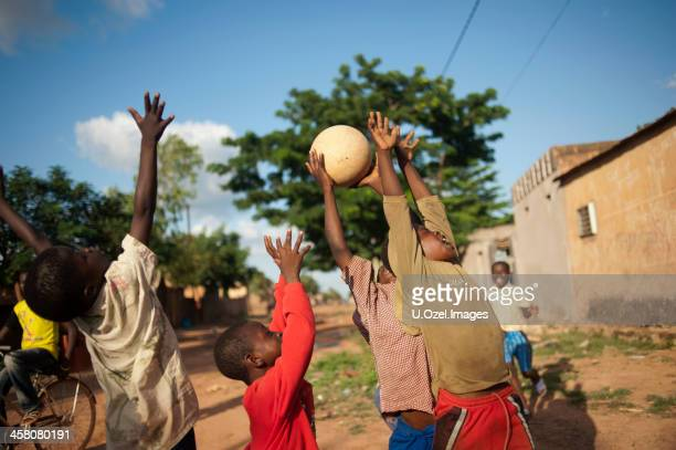 fun of football - burkina faso stock pictures, royalty-free photos & images