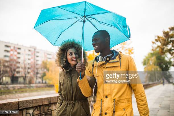 fun on a rainy day - blue jacket stock pictures, royalty-free photos & images