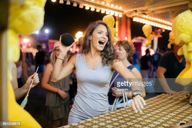 fun on knockdown game - carnival stock photos and pictures