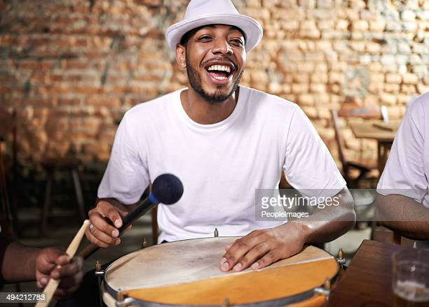 fun on the drum - brazilian men stock photos and pictures