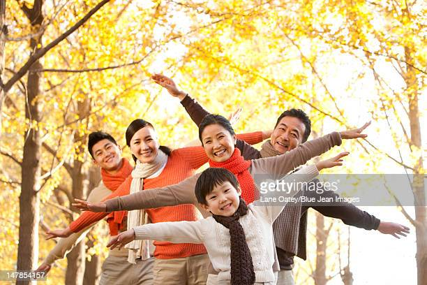 Fun outdoor family portrait in Autumn