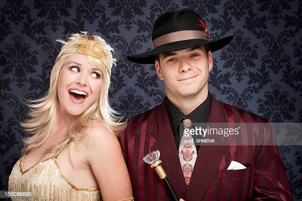fun retro gangster couple - period costume stock pictures, royalty-free photos & images