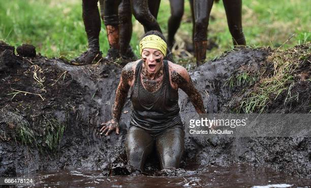 Fun runner jumps into a pool of mud as competitors take part in the annual McVities Mud Madness 8km cross country run on April 9, 2017 in Portadown,...