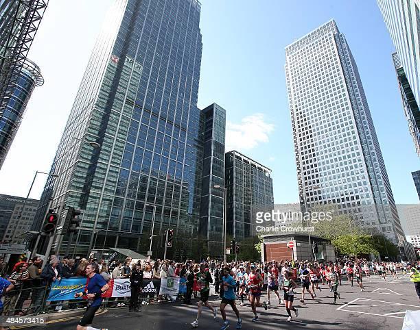 Fun Runners make their way through Canary Wharf during the Virgin Money London Marathon 2014 on April 13 2014 in London England
