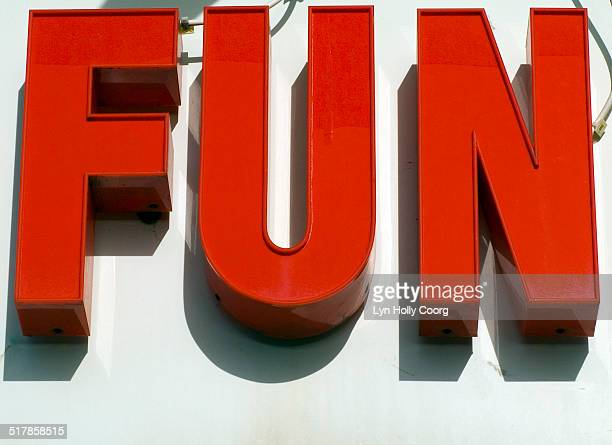 fun sign in red letters - lyn holly coorg stock-fotos und bilder