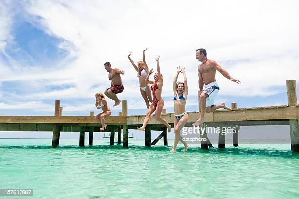 Fun time jumping into sea
