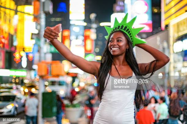 fun times in new york city - crown headwear stock pictures, royalty-free photos & images