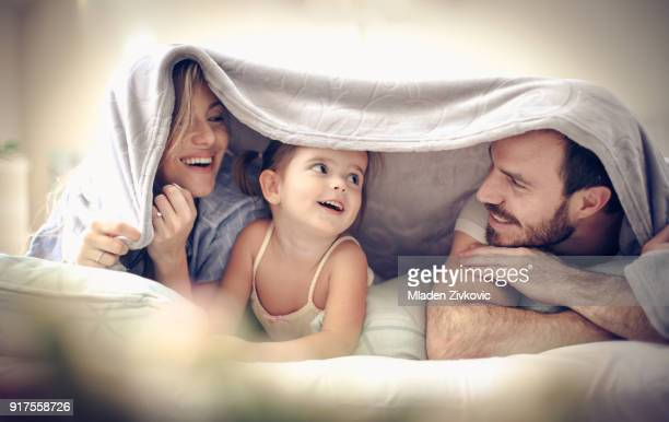 fun under blanket. - covering stock pictures, royalty-free photos & images