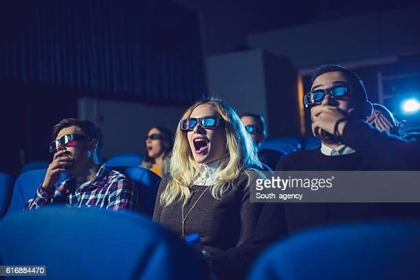 fun watching a movie - blue film video stock pictures, royalty-free photos & images
