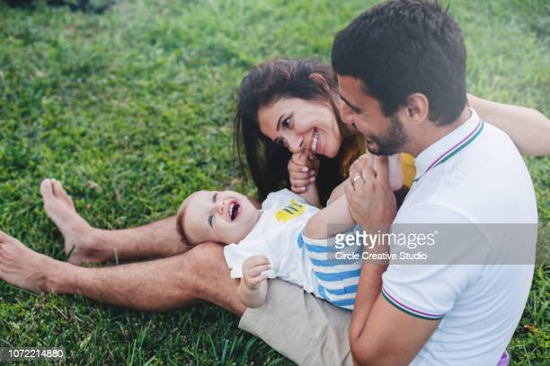 fun with baby boy - middle eastern ethnicity stock pictures, royalty-free photos & images