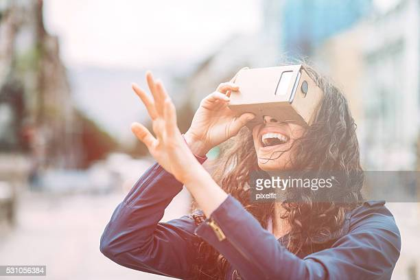 fun with cardboard virtual reality simulatop - redoubtable film stock photos and pictures