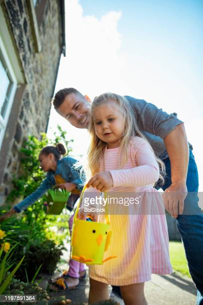 fun with family this easter - easter egg hunt stock pictures, royalty-free photos & images