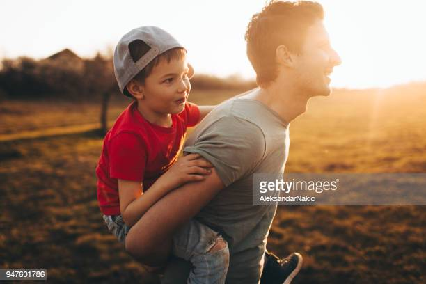 fun with my dad - modern manhood stock pictures, royalty-free photos & images