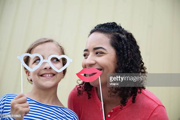 fun with paper masks - caricature stock pictures, royalty-free photos & images
