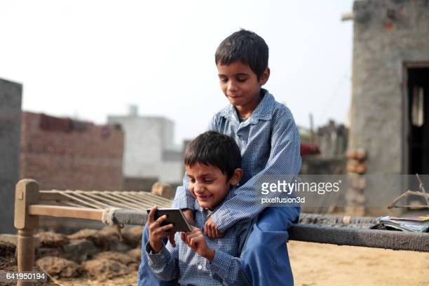 fun with smartphone at home - developing countries stock photos and pictures