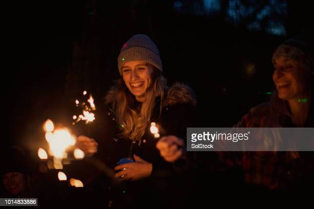 fun with sparklers - bonfire stock photos and pictures