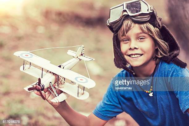 fun with the plane - budding tween stock photos and pictures