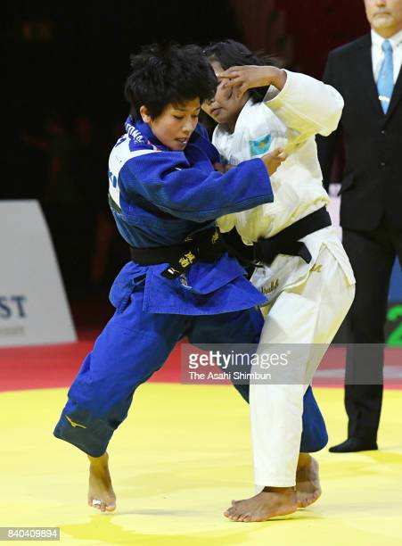 Funa Tonaki of Japan and Otgontsetseg Galbadrakh of Kazakhstan compete in the Women's 48kg semi final during day one of the World Judo Championships...