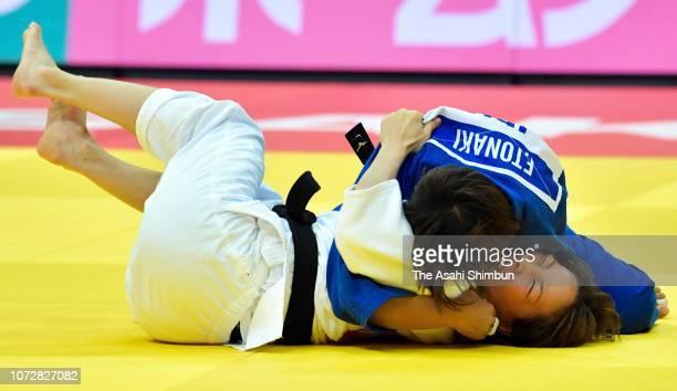 Funa Tonaki of Japan and Urantsetseg Munkhbat of Mongolia compete in the Women's 48kg final on day one of the Grand Slam Osaka at Maruzen Intec Arena...