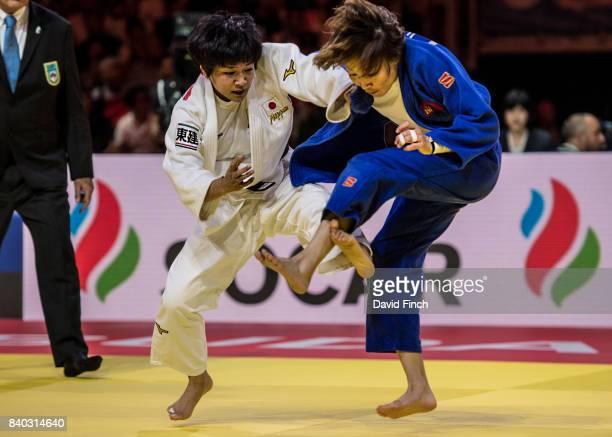 Funa Tonaki of Japan attacks Urantsetseg Munkhbat of Mongolia eventually winning the u48kg gold medal by a wazari during the 2017 Suzuki World Judo...