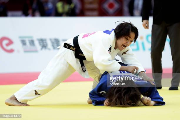 Funa Tonaki of Japan competes against Hiromi Endo of Japan in the Women's 48kg semifinal match on day one of the Grand Slam Osaka at Maruzen Intec...