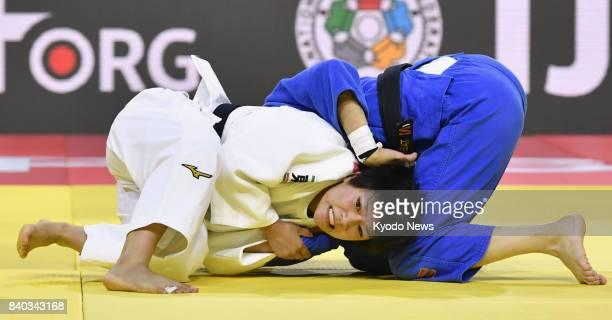 Funa Tonaki of Japan competes against Urantsetseg Munkhbat of Mongolia in the women's 48kilogram final at the world judo championships in Budapest on...