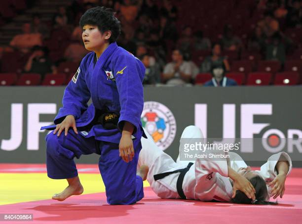 Funa Tonaki of Japan reacts after her victory over Milica Nikolic of Serbia in the Women's 48kg quarter final during day one of the World Judo...