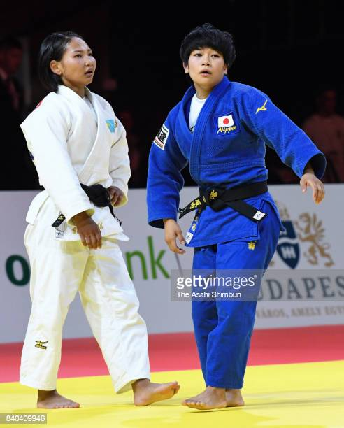 Funa Tonaki of Japan reacts after her victory over Otgontsetseg Galbadrakh of Kazakhstan in the Women's 48kg semi final during day one of the World...