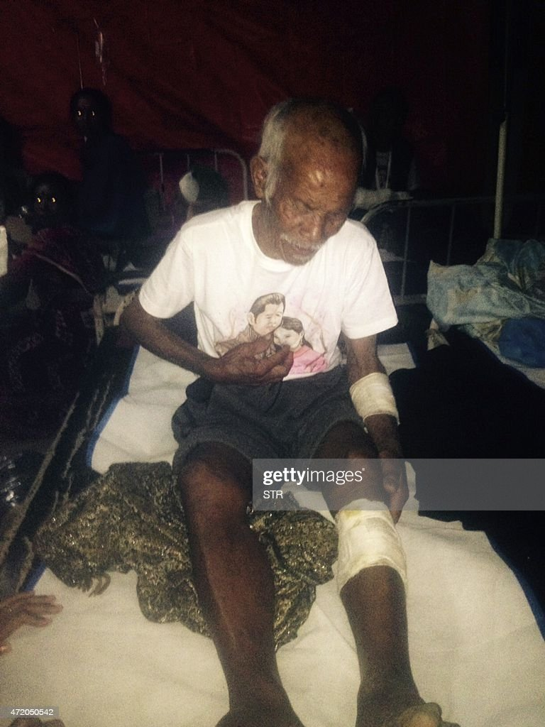Funchu Tamang, 101, sits on a bed in a hospital in Nuwakot district on May 3, 2015 around 80 kilometres (50 miles) northwest of Kathmandu where he was taken after being rescued from his collapsed h...