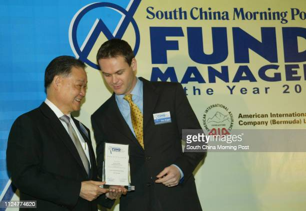 Fund Manager Award at Mandarin Oriental Hotel Central 21 February 2005 Alwin Lam executive vice president and GM of AIA present award to Alex Boggis...