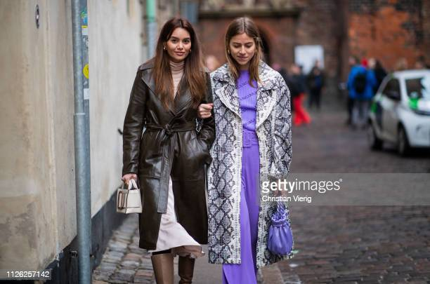 Funda Christophersen and Trine Kjaer wearing coat with snake print purple pants and top is seen outside Holzweiler during the Copenhagen Fashion Week...