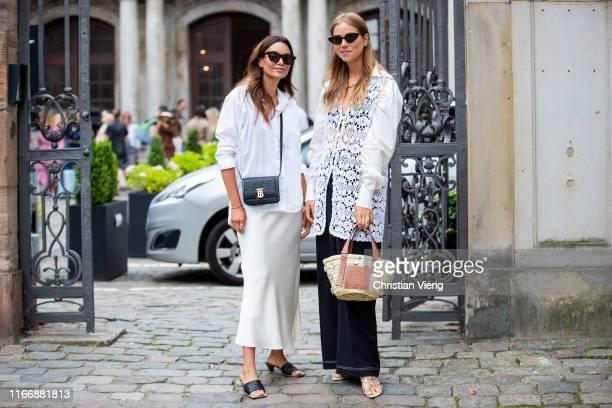 Funda Christophersen and Trine Kjaer wearing Loewe bag seen outside Hofmann Copenhagen during Copenhagen Fashion Week Spring/Summer 2020 on August...