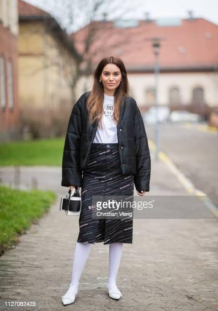 Funda Christophersen is seen wearing Balenciaga skirt black puffer jacket white tights outside Baum und Pferdgarten during the Copenhagen Fashion...