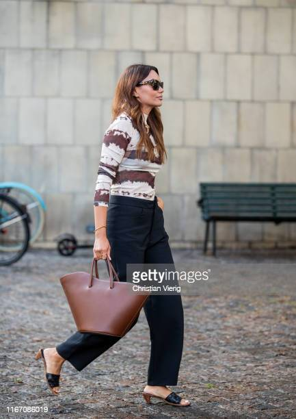Funda Christophersen is seen wearing navy pants brown white striped turtleneck brown bag outside Saks Potts during Copenhagen Fashion Week...