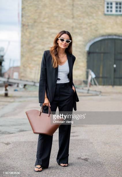 Funda Christophersen seen wearing black blazer, pants, brown bag outside Stine Goya during Copenhagen Fashion Week Spring/Summer 2020 on August 08,...