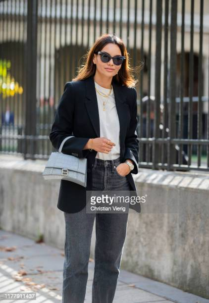 Funda Christophersen seen wearing denim jeans, black blazer, Balenciaga bag outside Cédric Charlier during Paris Fashion Week Womenswear Spring...