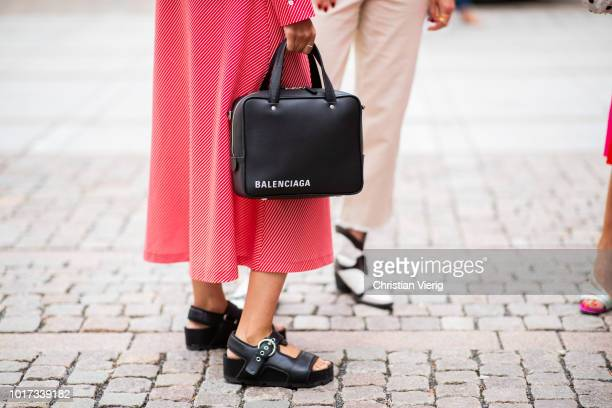 Funda Christophersen weairng Balenciaga bag sandals pink dress seen outside Line of Oslo during Oslo Runway SS19 on August 15 2018 in Oslo Norway