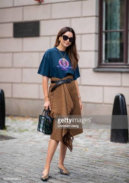 Funda Christophersen wearing brown skirt Balenciaga bag seen during Stockholm Runway SS19 on August 29 2018 in Stockholm Sweden