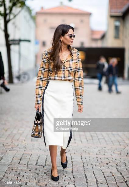 Funda Christophersen wearing checked Burberry button shirt and white midi skirt black heels Prada sunglasses seen outside Cathrine Hammel during Oslo...