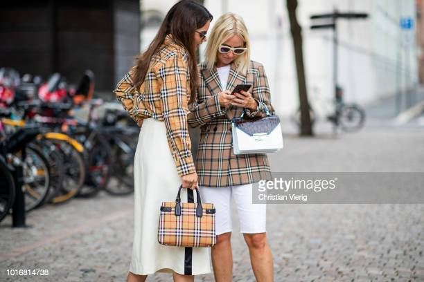 Funda Christophersen wearing checked Burberry button shirt and white midi skirt black heels Prada sunglasses seen outside Cathrine Hammel during Oslo...