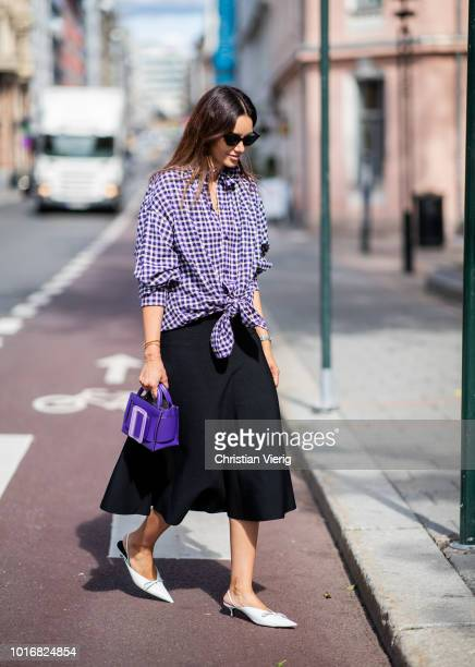 Funda Christophersen wearing checked button skirt black midi skirt purple bag seen outside Anne Karine Thorbjornsen during Oslo Runway SS19 on August...