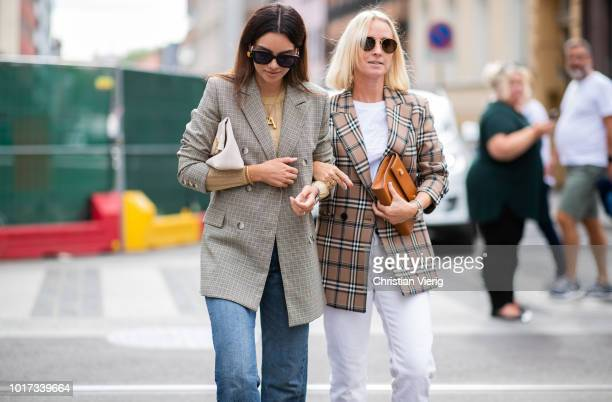 Funda Christophersen wearing clutch cropped denim jeans checked blazer seen outside Pia Tjelta during Oslo Runway SS19 on August 15 2018 in Oslo...