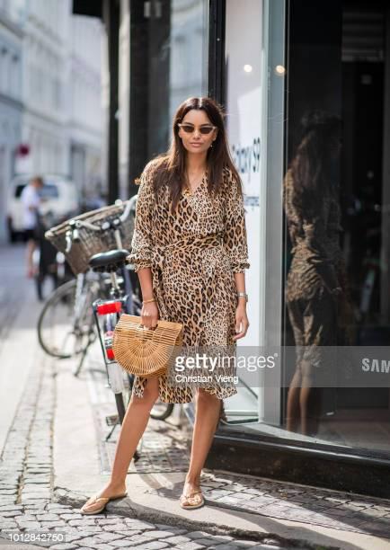 Funda Christophersen wearing dress with leopard print Clut Gaia bag seen outside Blanche during the Copenhagen Fashion Week Spring/Summer 2019 on...