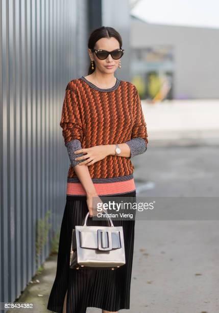 Funda Christophersen wearing knit silver bag and black skirt outside By Malene Birger on August 09 2017 in Copenhagen Denmark