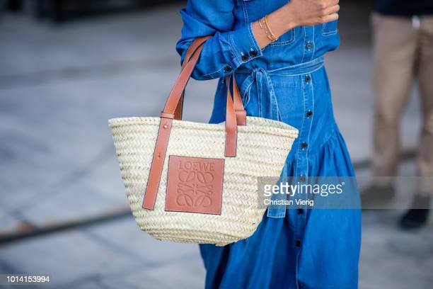 Funda Christophersen wearing Loewe bag is seen outside Designers Remix during the Copenhagen Fashion Week Spring/Summer 2019 on August 9 2018 in...