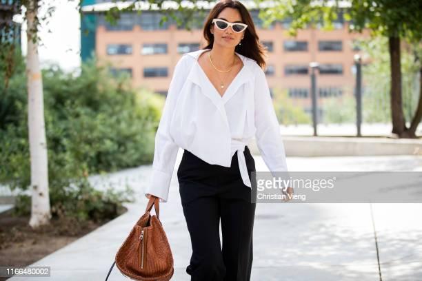 Funda Christophersen wearing white button shirt black pants brown Loewe bag outside Brøgger during Copenhagen Fashion Week Spring/Summer 2020 on...